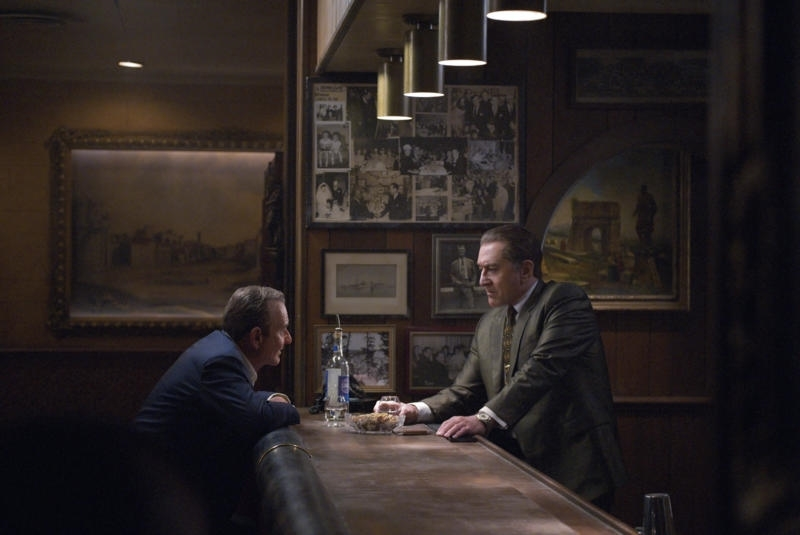 image of Joe Pesci and Robert DeNiro in the Irishman. The two are speaking across a bar counter to each other.