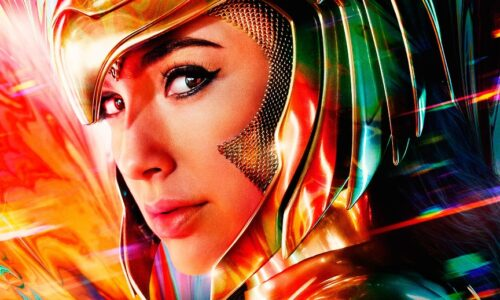 wonder woman 84 poster - a close up of Wonder Woman in her golden armor with neon colors